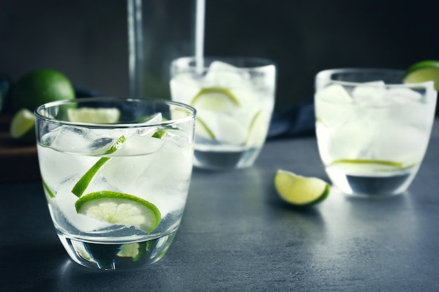 Alcohol cocktail with lime on table