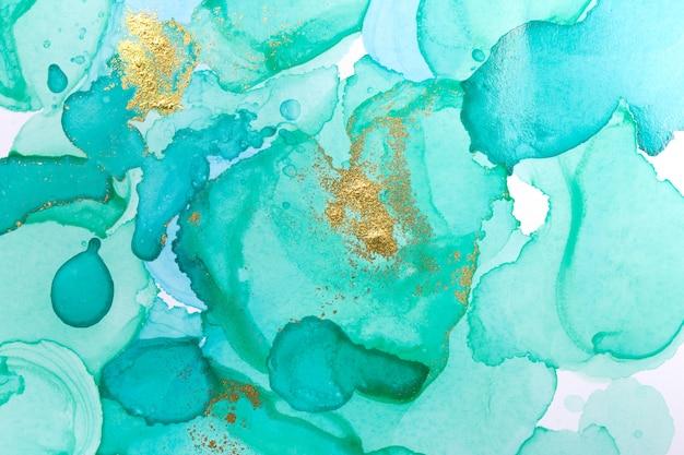 アルコールインクブルー抽象的な背景。オーシャンスタイルの水彩テクスチャ。青と金の塗料汚れ