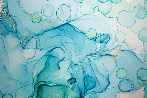 Alcohol ink blue handdrawn watercolor drops on white background. bubbles imitation.