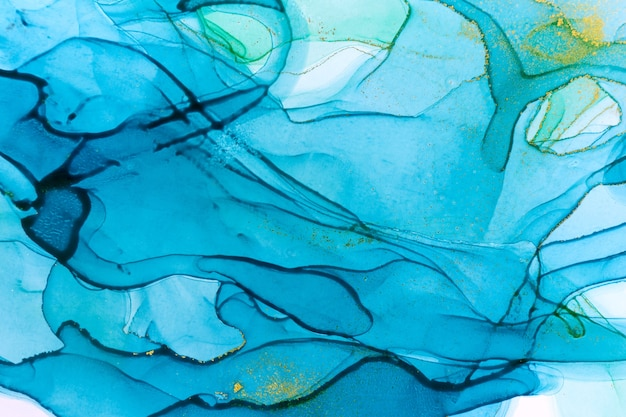 アルコールインクブルー透明背景。抽象的なスタイルの水彩画のドロップテクスチャ。