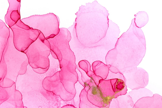 Alcohol ink pink abstract background. floral style watercolor texture. pink and gold paint stains