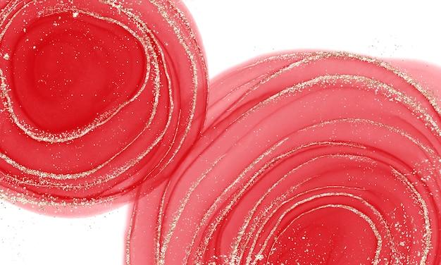 Спиртовая жидкость с красными чернилами с золотыми блестками Premium Фотографии