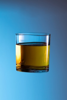 Alcohol liquor whisky cause of accident splash in clear glass night life party drink don't drive