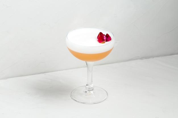 Alcohol sweet sour foam cocktail with flower