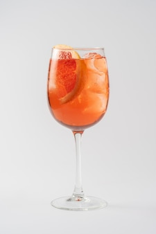 Alcoholic cocktail aperol syringe with grapefruit in glass goblet