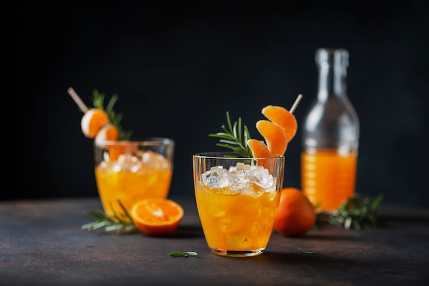 Alcoholic cocktail with mandarins