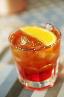 Alcoholic cocktail with orange slices