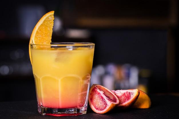 Alcoholic cocktail with orange