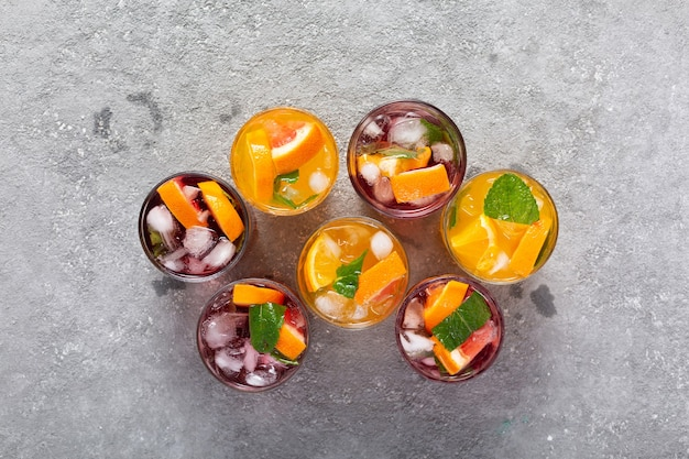 Alcoholic cocktails with ice and fruit at the bar