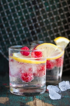 Alcoholic drink with raspberries