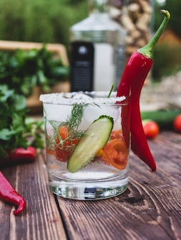 Alcoholic drink with red pepper and ice