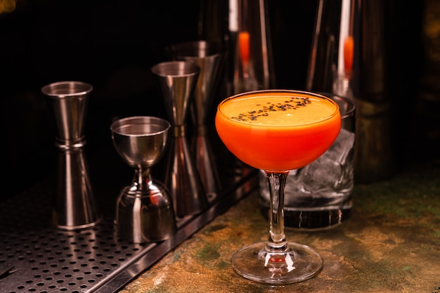 Alcoholic orange cocktail at the bar. carrot cocktail.