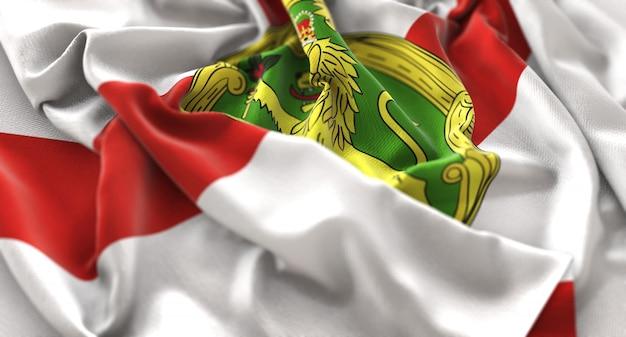 Bandiera di alderney increspato splendamente sventolando macro close-up shot