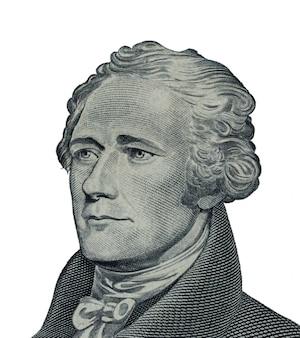 «александр гамильтон» - лицо на макросе купюры 10 или 10 долларов сша, крупный план денег сша на белом фоне