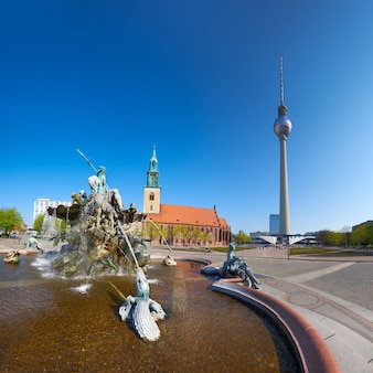 Alexanderplatz, neptune fountain and the tv tower in berlin
