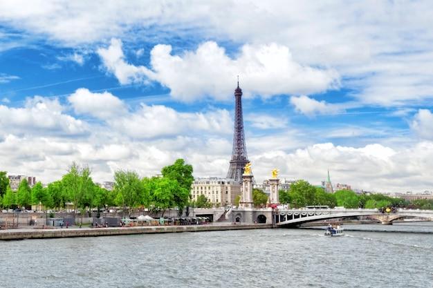 Alexandre iii bridge over the seine and the eiffel tower on skyline. paris. france.