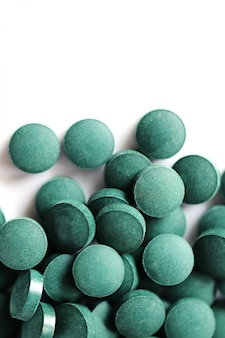 Algae spirulina tablets. super food concept.