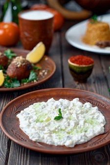 Ali nazik meze, traditional turkish dish of yoghurt and eggplant puree topped with a mint leaf