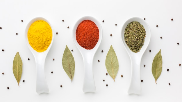 Aligned spoons with spicy powder