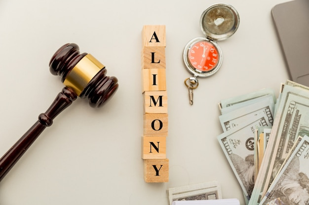 Alimoney document on the tablet and wooden gavel.