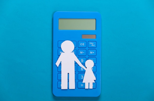 Alimony. inferior family. paper father and daughter with a calculator on blue