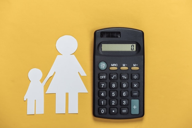 Alimony. inferior family. paper mom and son with a calculator on a yellow