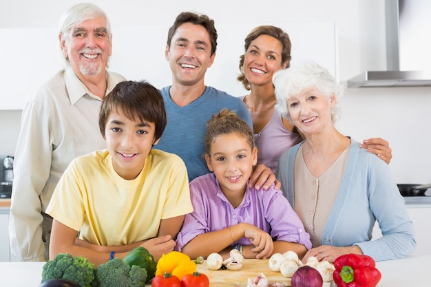 All the family smiling in kitchen