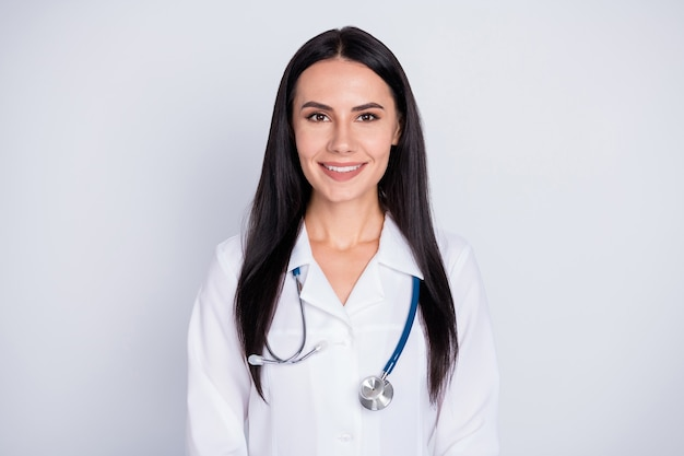All is well photo of attractive doctor practitioner lady good mood friendly smiling to patients wear white lab coat stethoscope isolated grey color background