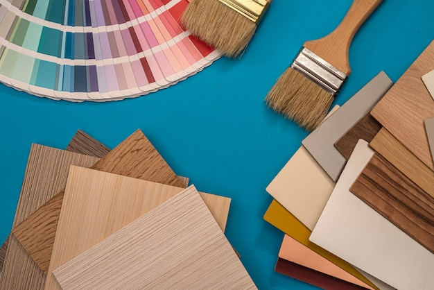All item for repair and design, paint brush with vinyl color samples, industry
