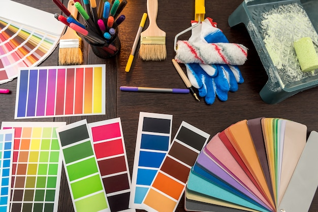 All tools for repair renovation home, paintbrush and color sampler for best choice. colour palette