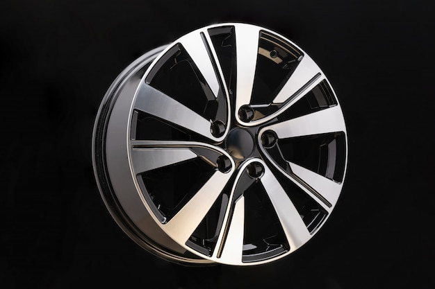 Alloy rim on black wall, alloy wheels closeup. the elements spokes