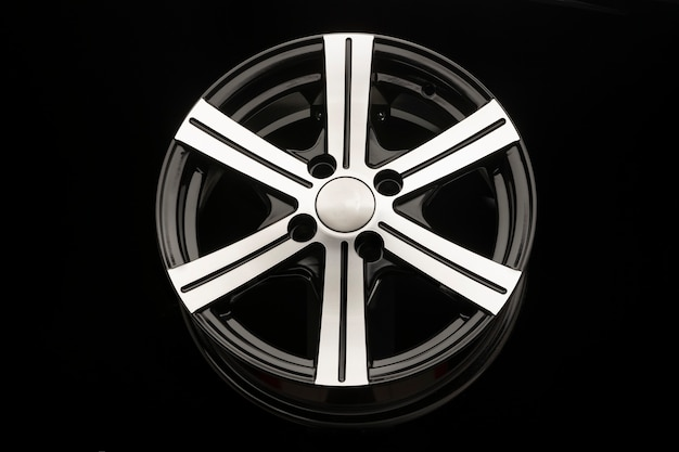 Alloy wheel, black with polishing. front view close-up.