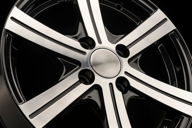 Alloy wheel, black with polishing. side view close-up. empty cover without logo.