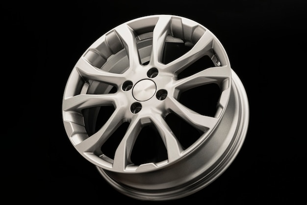 Alloy wheels on a black table. new spare parts for the car or car tuning