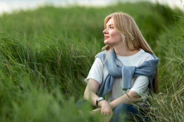 Alluring woman posing in grass