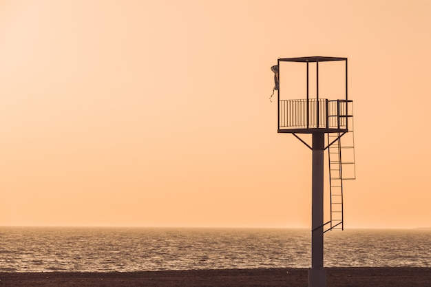 Almerimar beach lifeguard tower at sunset.