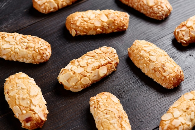 Almond baked cookie on wooden table background