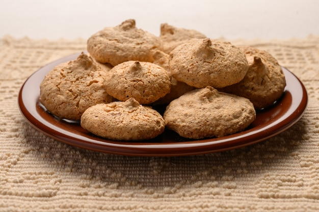 Almond biscuits on a plate on a linen napkin. top view. copy space.