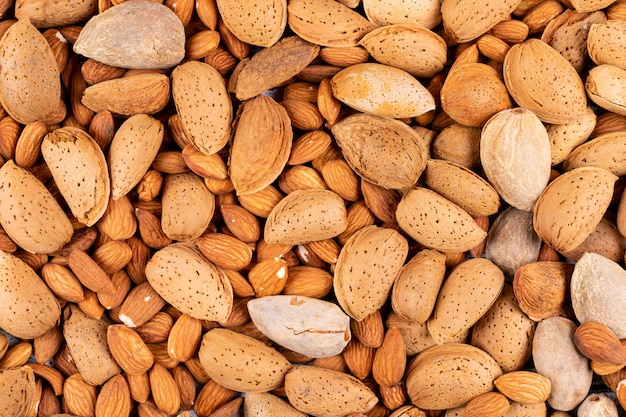 Almond closeup background, top view