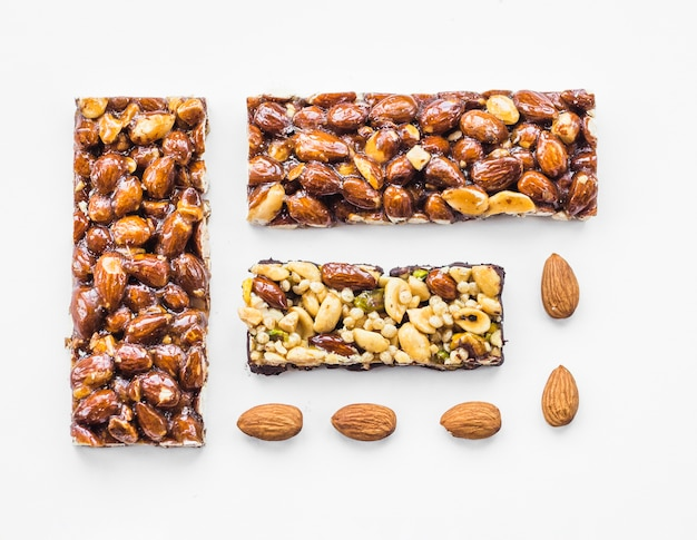 Almond and dried fruits bar isolated on white backdrop