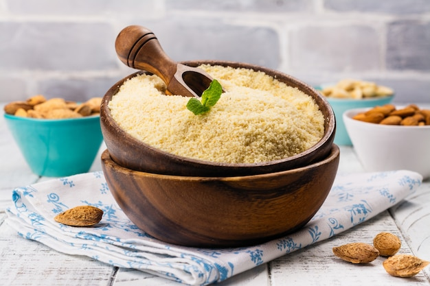 Almond flour in a wooden bowl