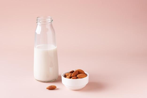 Almond milk on beige background