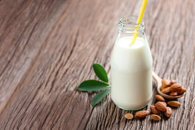 Almond milk in bottle with almonds nut
