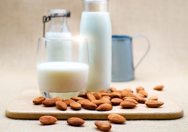 Almond milk in a glass bottle image photo