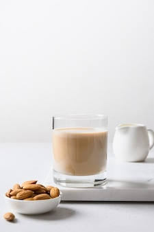 Almond milk in glass bottle and nut healthy vegan eating