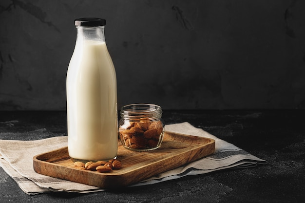 Almond milk with almond nuts in glass