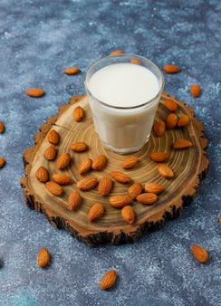 Almond milk with almond, top view