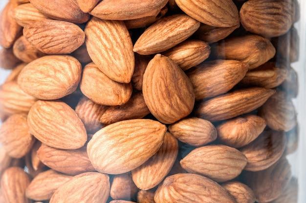 Almond nut in a glass jar closeup.