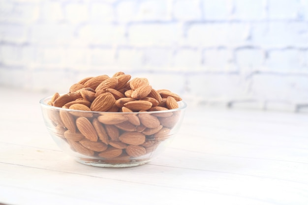 Almond nuts in a bowl on table with copy space