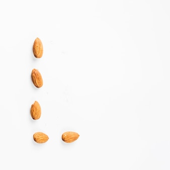 Almond nuts isolated on white backdrop